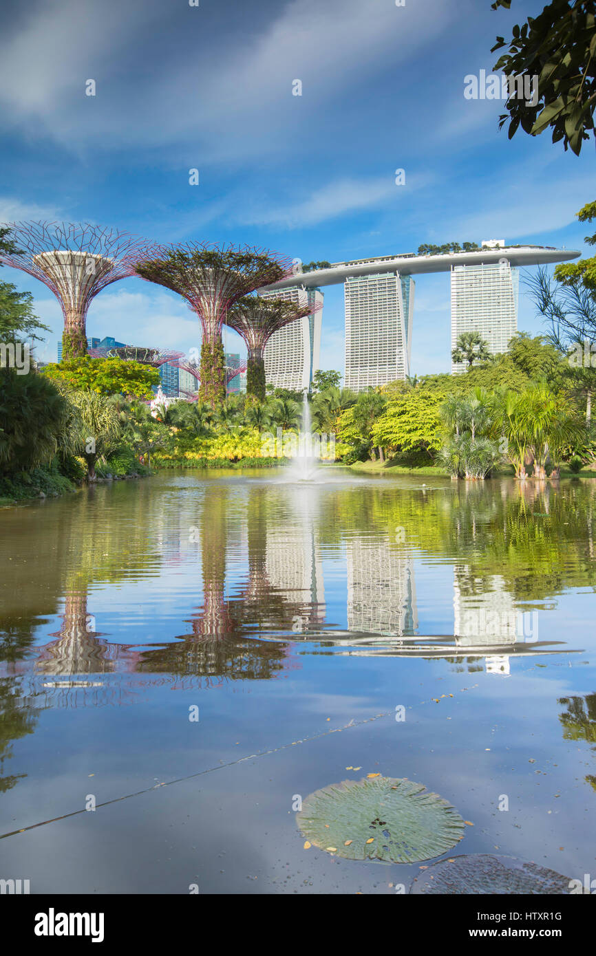 Gardens by the Bay and Marina Bay Sands Hotel, Singapore - Stock Image