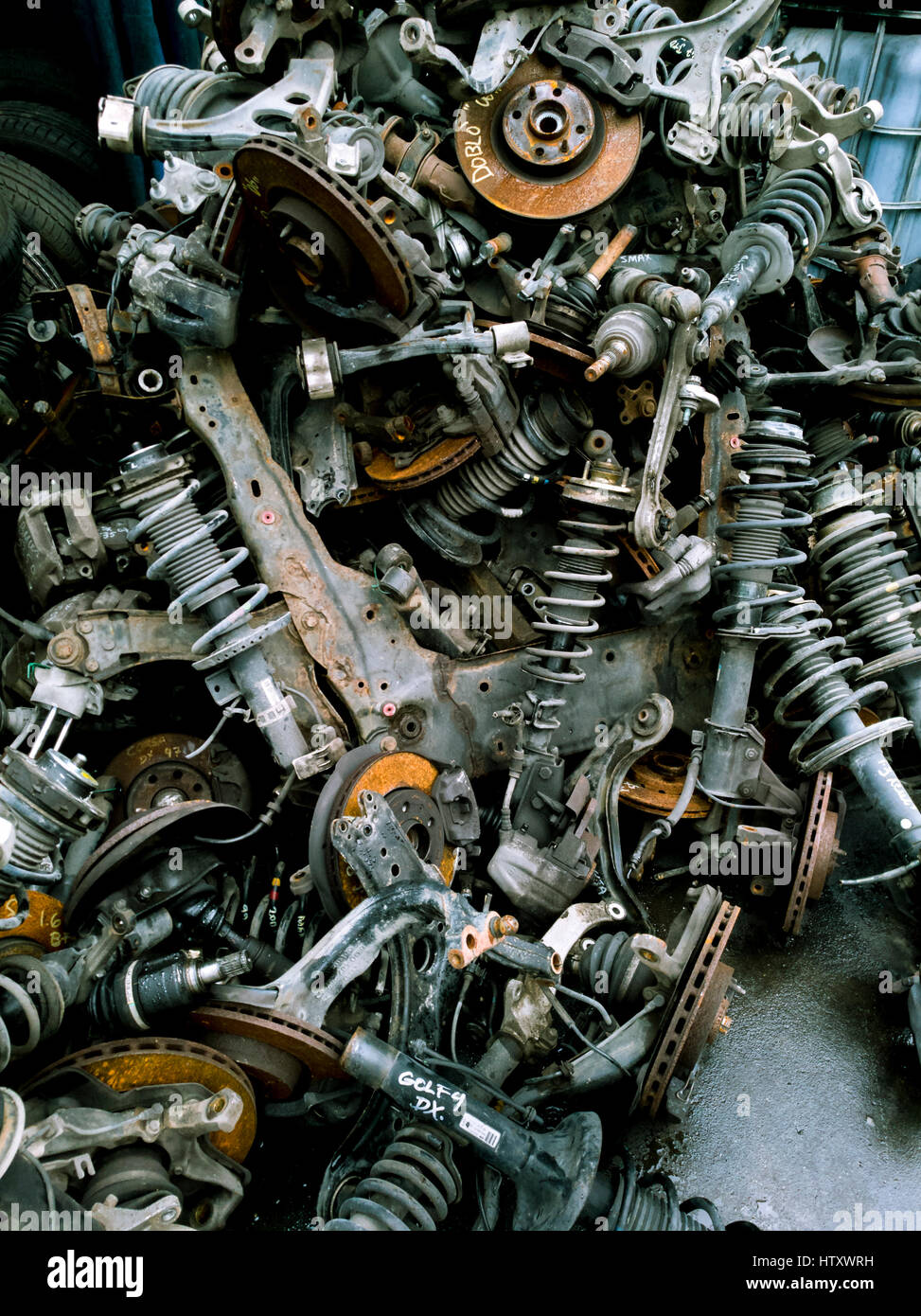 Pile of old car shock absorbers and brake hub  for recycling - Stock Image