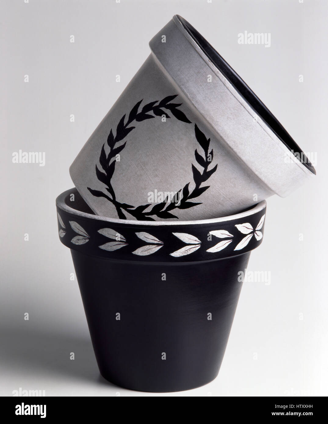 Close Up Of Black And White Painted Flower Pots With A Stenciled