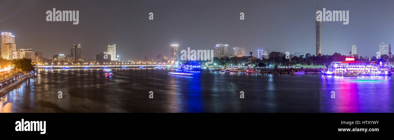 Panoramic view of Cairo city center at night, the Kasr El Nile Bridge and the island of Zamalek with its colorful - Stock Image