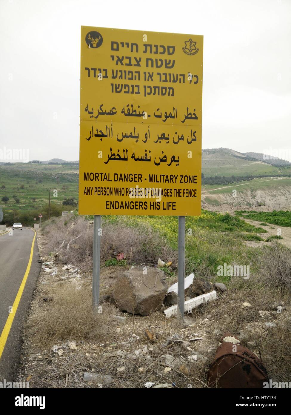 Israel, Golan Heights. The Syrian Israeli border fence as seen from the Israeli side - Stock Image