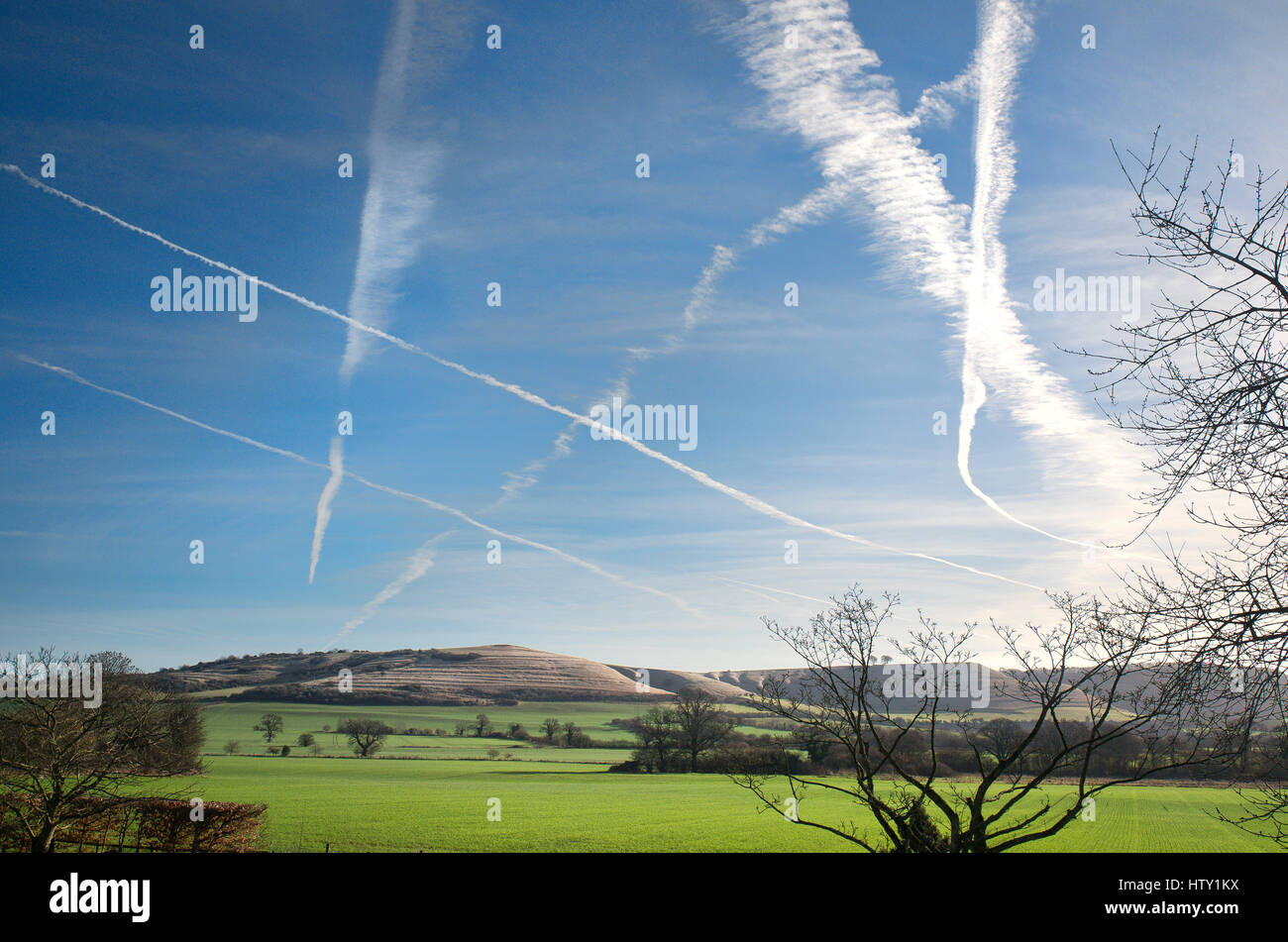 Patterns in the sky formed by high altitude overflying aircraft in Wiltshire UK - Stock Image