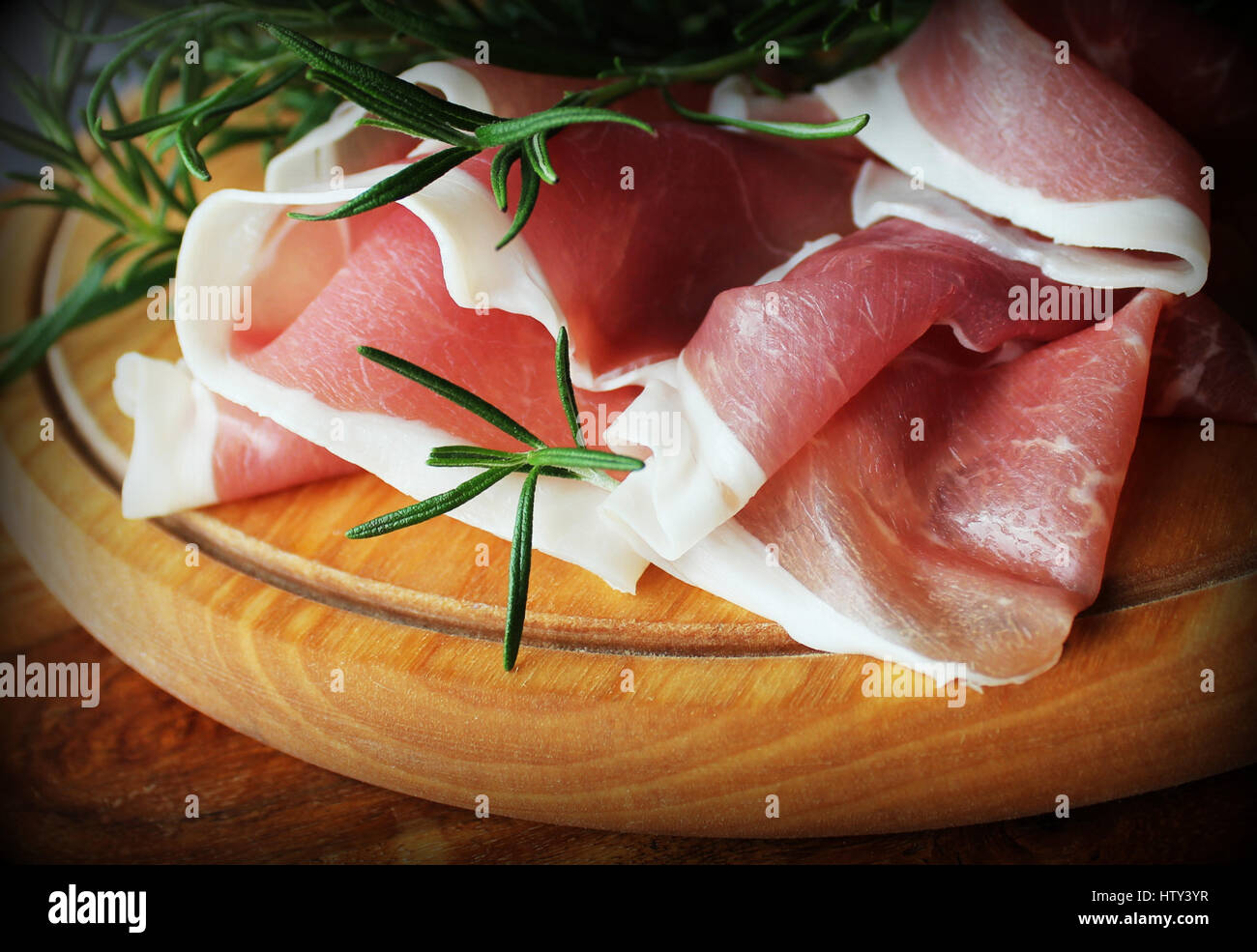 slices of ham on a cutting board - Stock Image