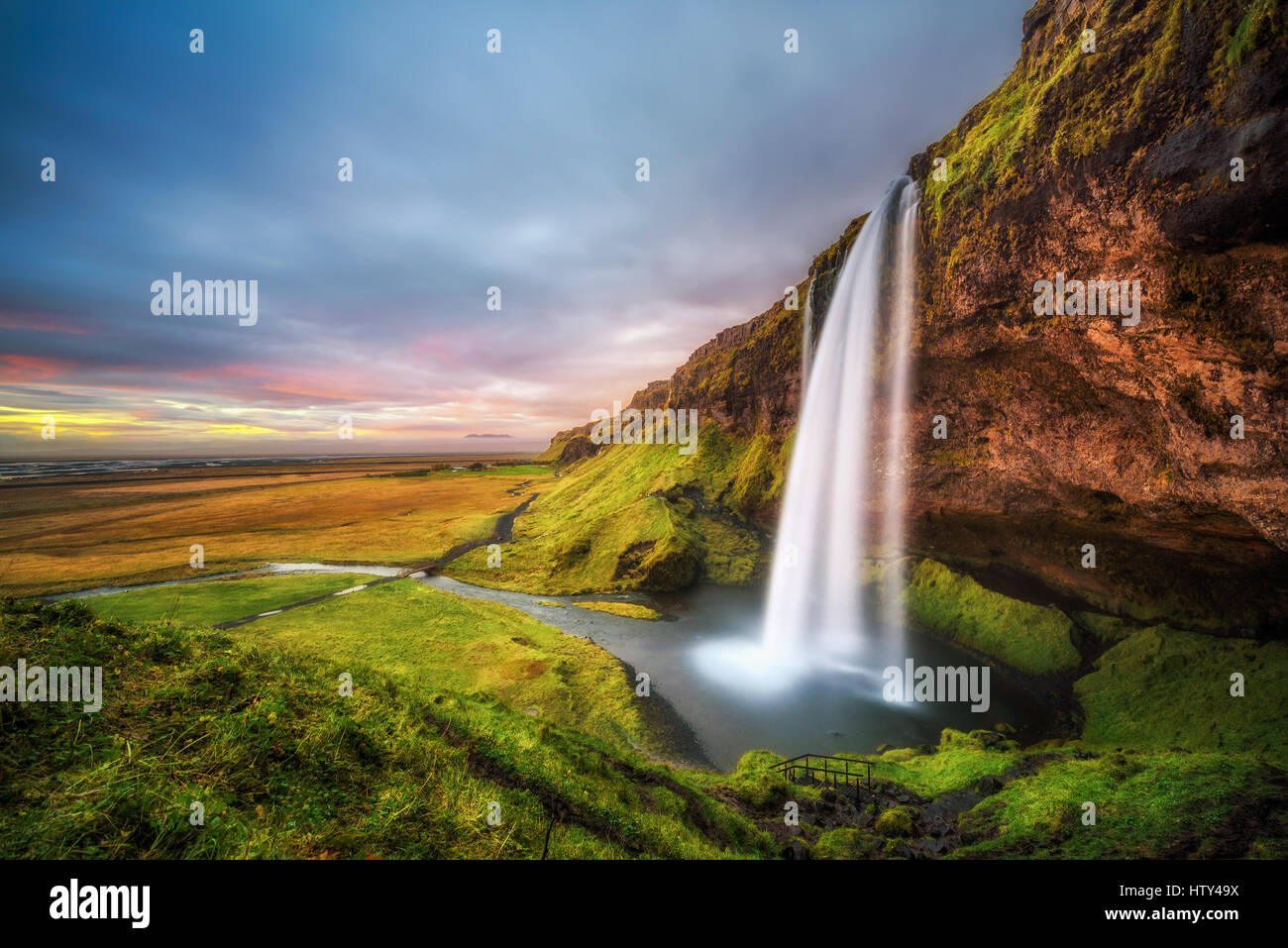 Seljalandsfoss Waterfall  in Iceland at sunset. Long exposure. - Stock Image