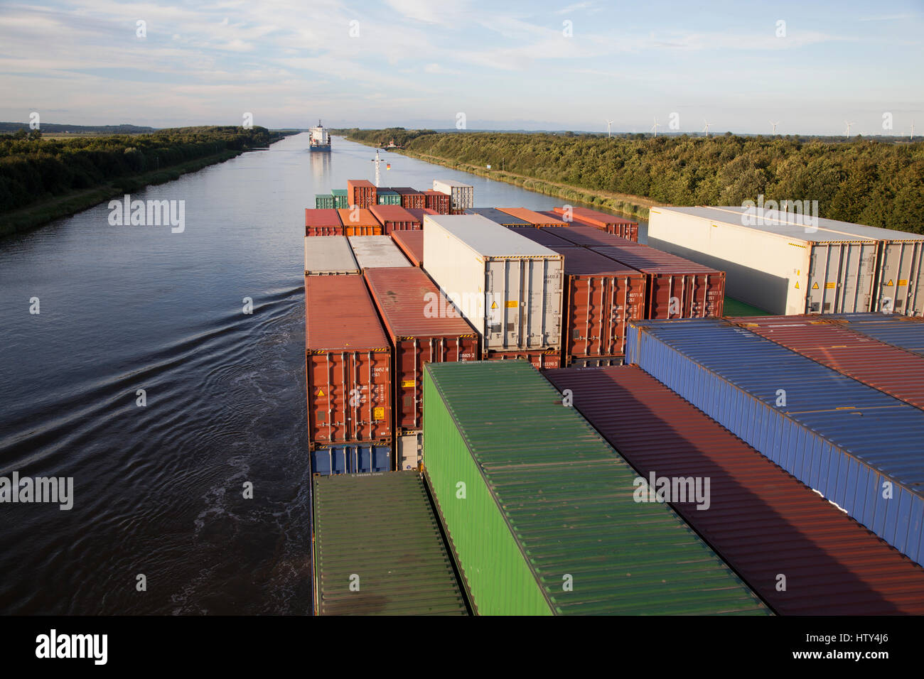 Containership on Kiel Canal, Germany - Stock Image