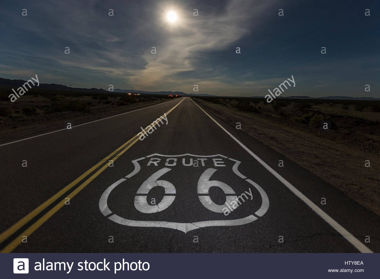 Full moon over Route 66 in the California Mojave desert. - Stock Image