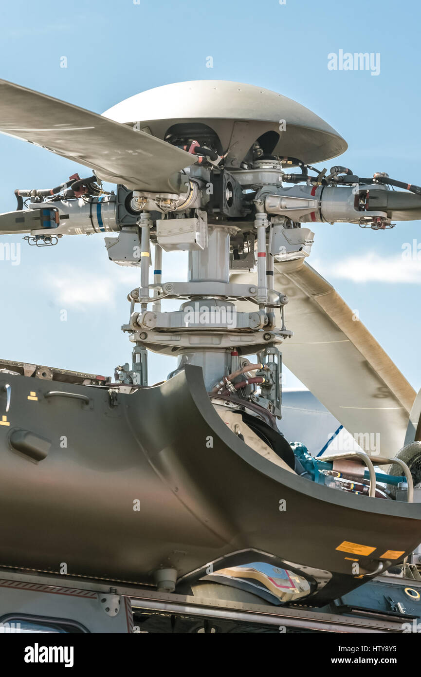 closeup of a complex helicopter rotor blade mechanical parts - Stock Image