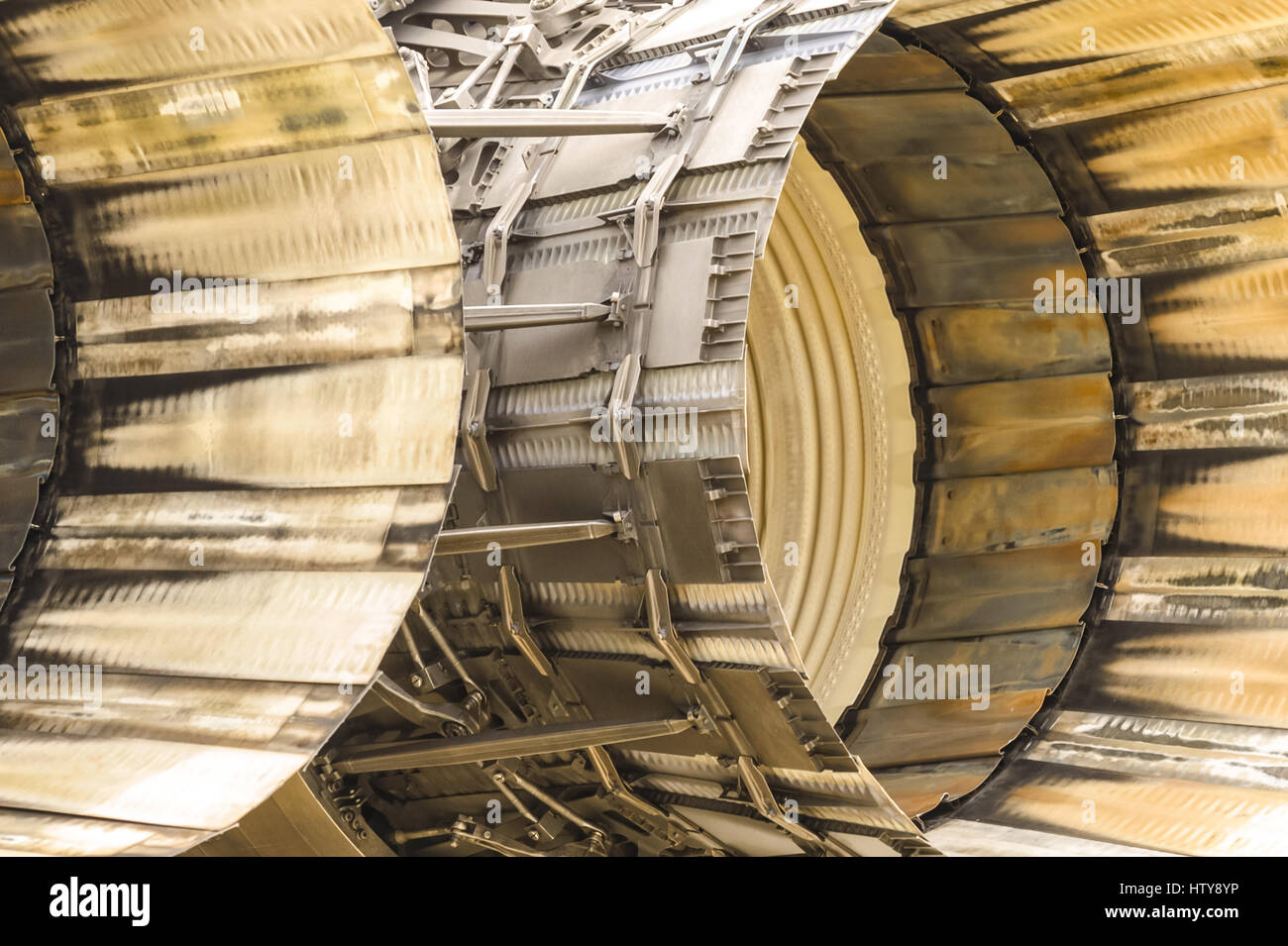 abstract of scorched engine thrust outlets on a military jet - Stock Image