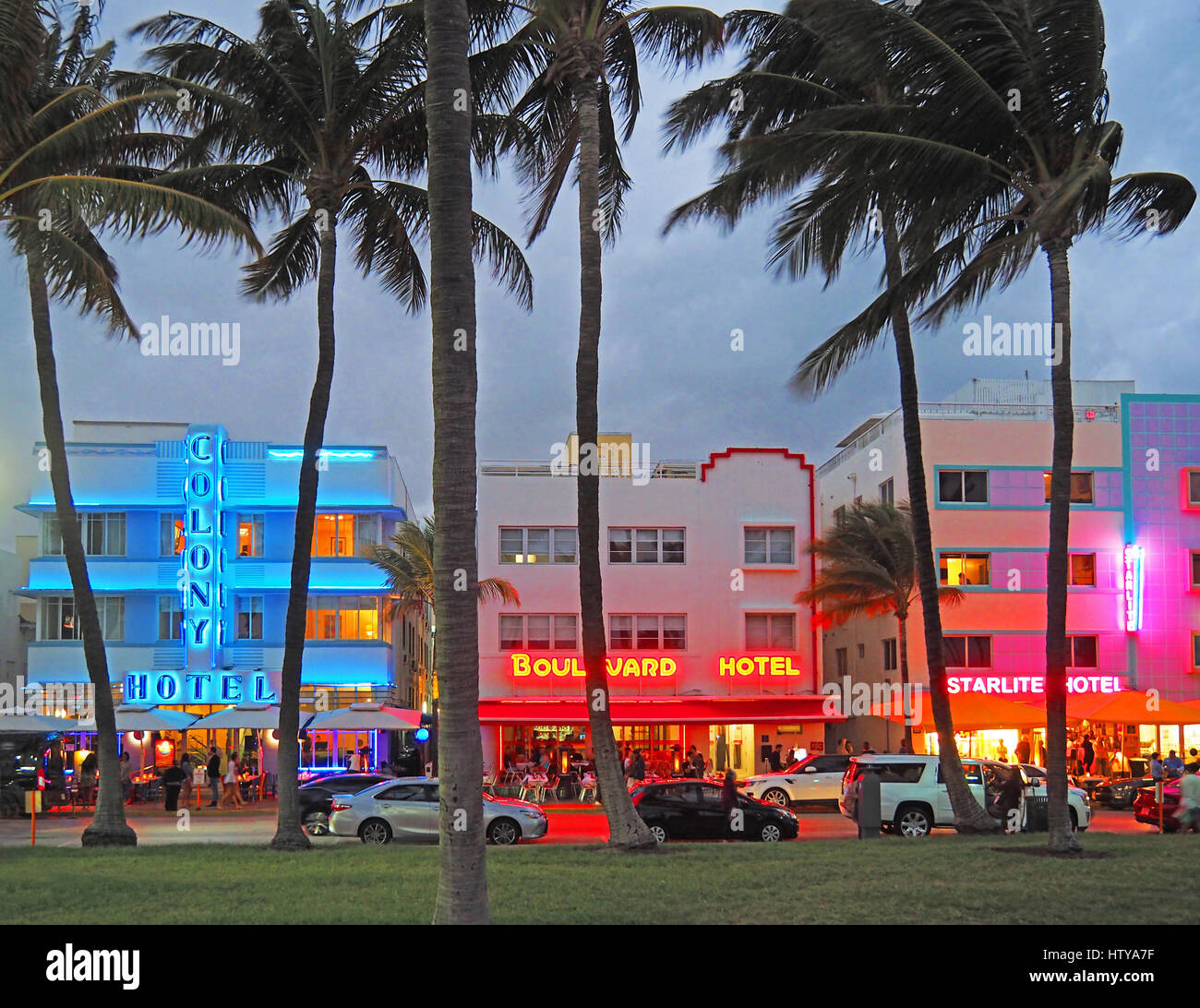 Art Deco District neon on hotels at dusk in Miami's South Beach. - Stock Image