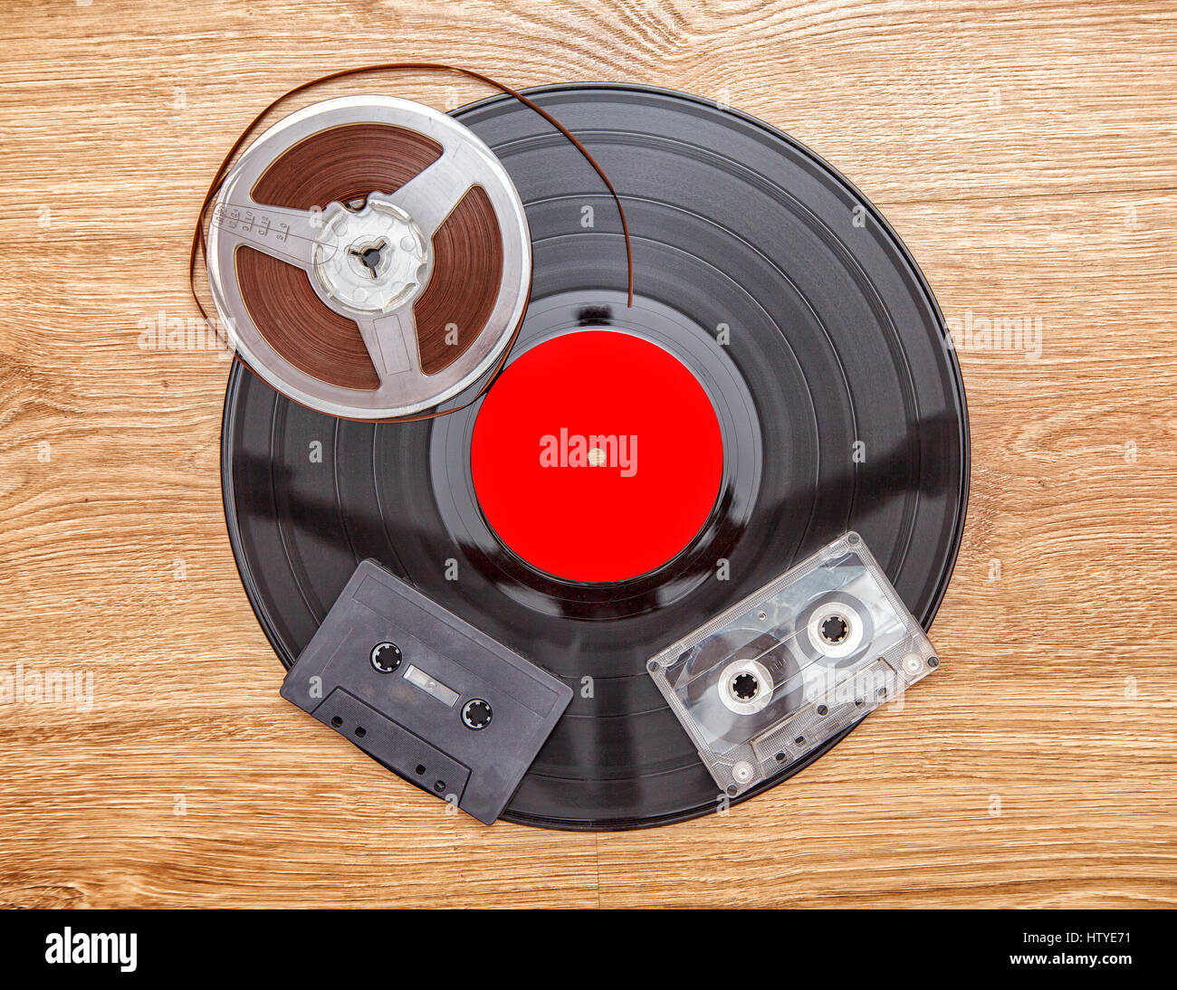 vinyl record with cassette tapes and reel tape - Stock Image