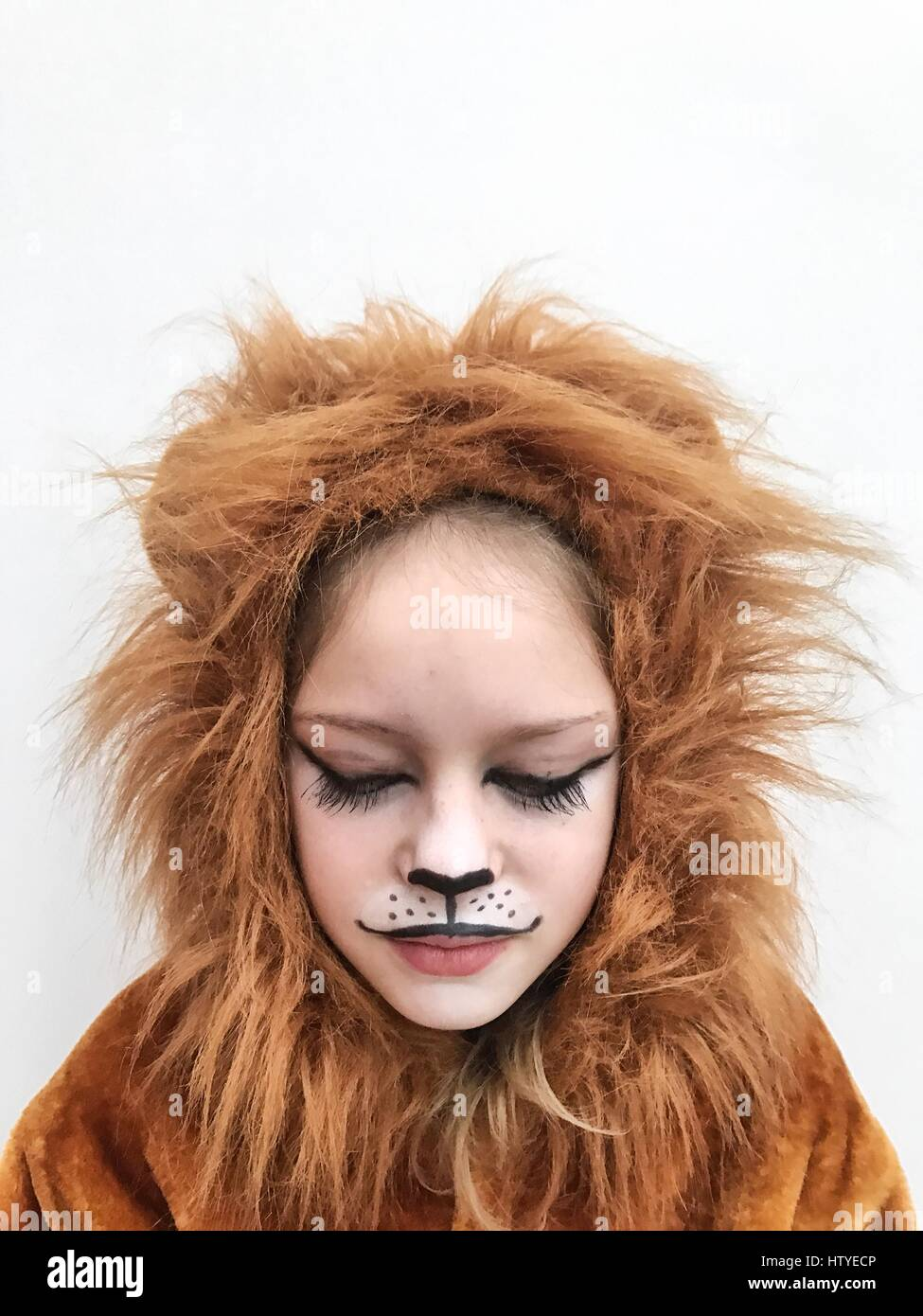 Girl wearing a lion costume - Stock Image