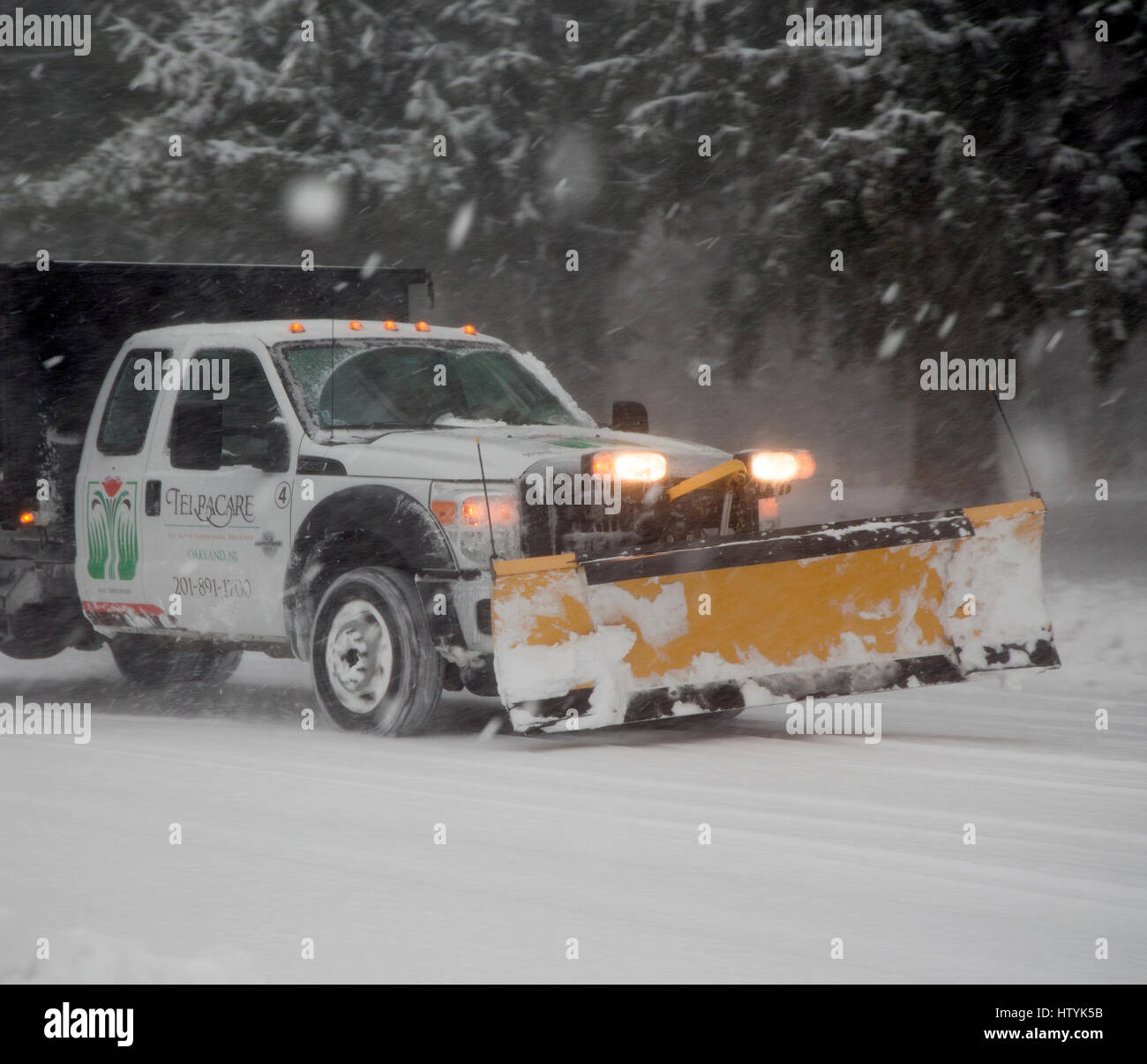A snowplow in a snowstorm - Stock Image