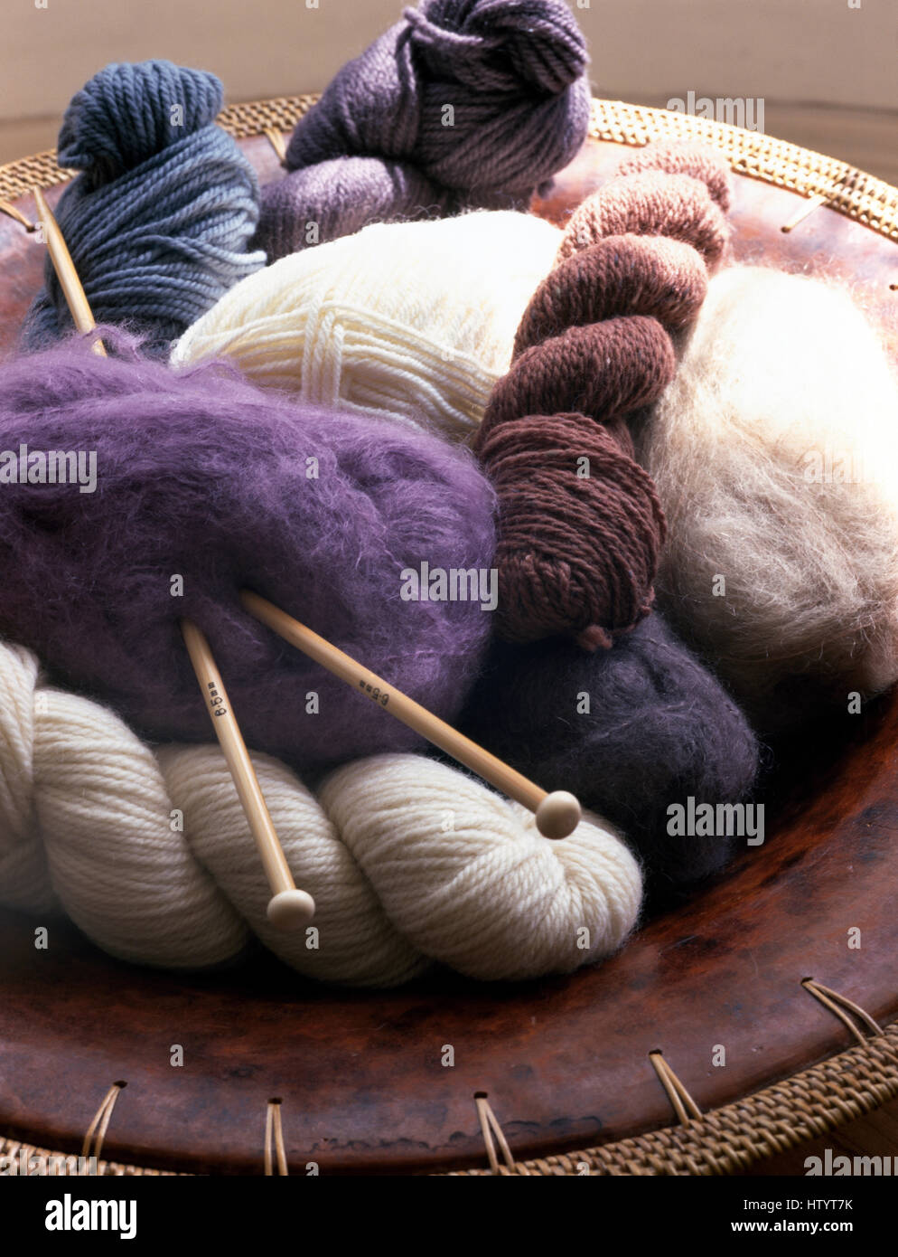 Close-up of skeins of wool and knitting needles Stock Photo