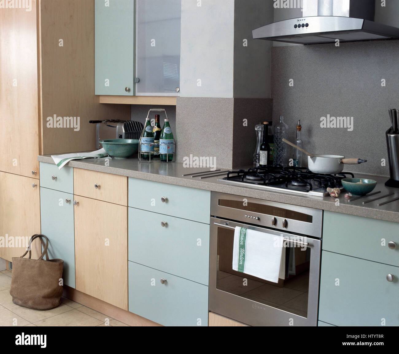 Plain Pale Wood And Pale Blue Fitted Units In A Modern Grey Kitchen - Pale grey kitchen units