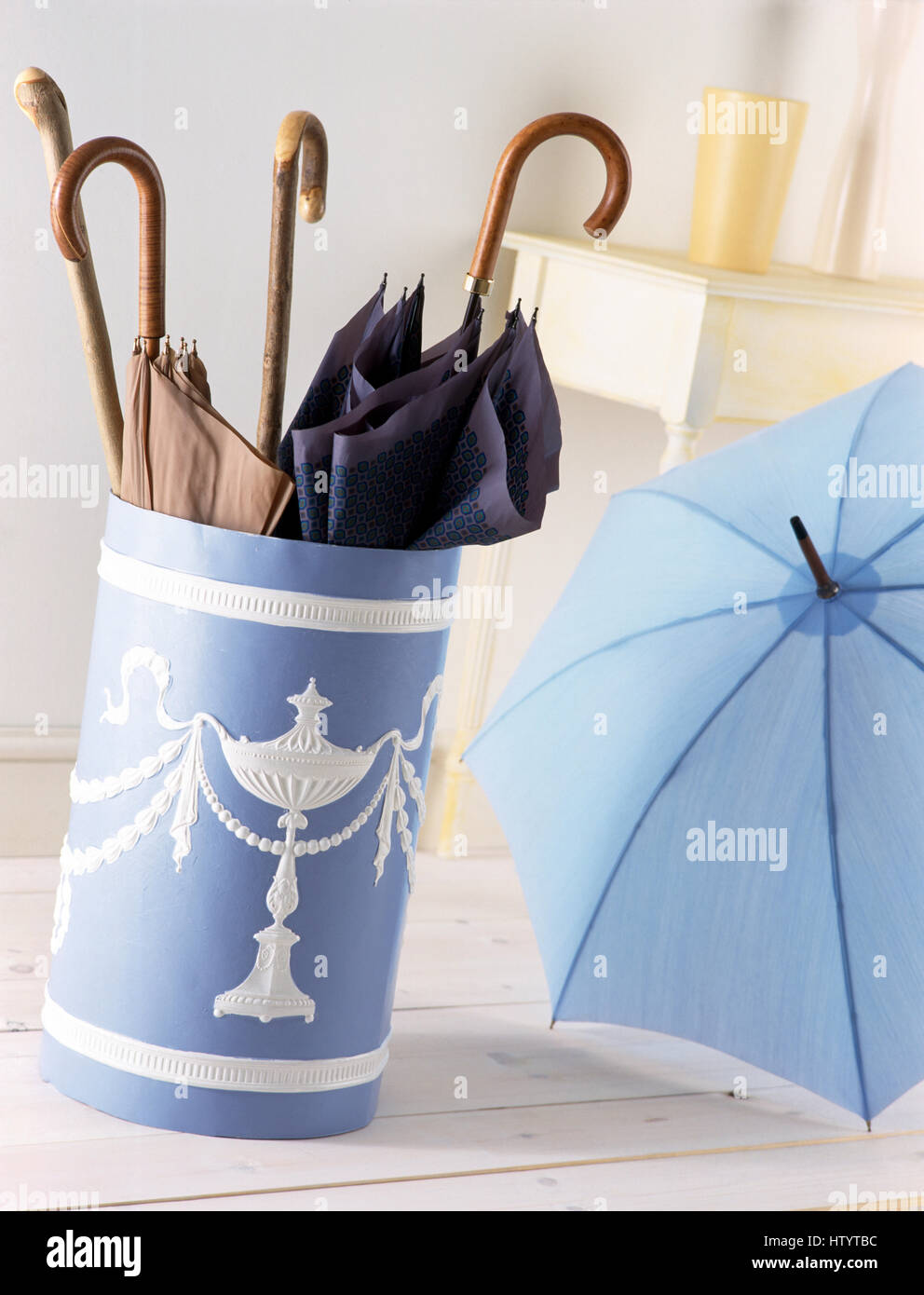 Close Up Of Umbrellas In An Umbrella Stand Painted In Blue And White  Wedgewood Style