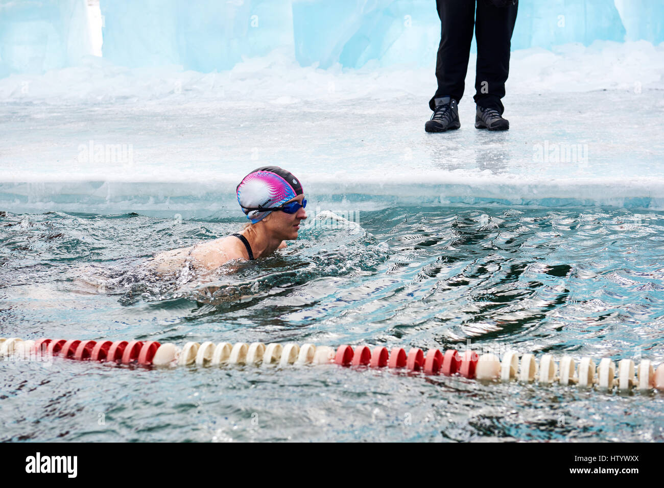 SAHYURTA, IRKUTSK REGION, RUSSIA - March 11.2017: Cup of Baikal. Winter Swimming Competitions. Woman swims - Stock Image