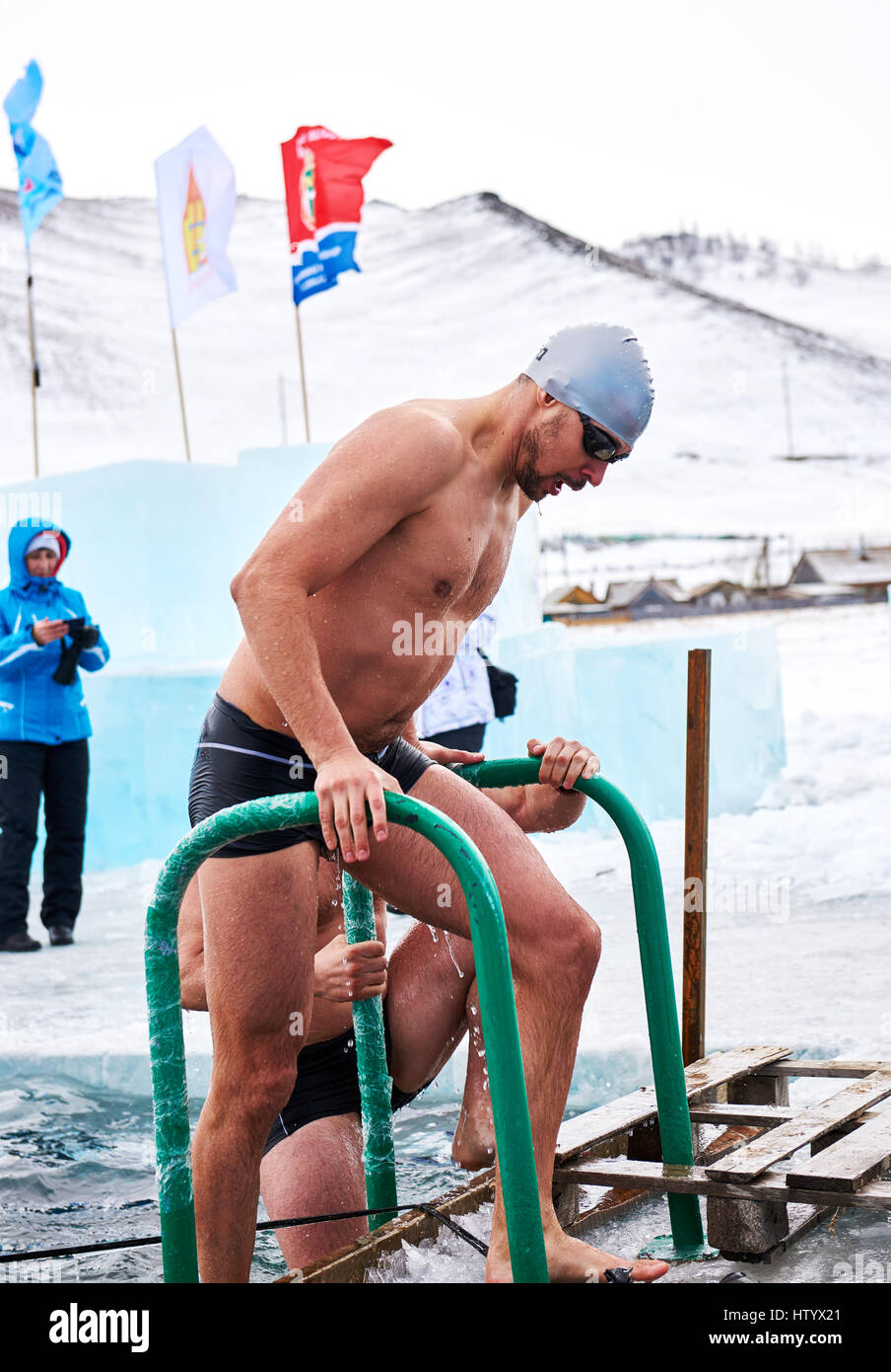 SAHYURTA, IRKUTSK REGION, RUSSIA - March 11.2017: Cup of Baikal. Winter Swimming Competitions. Swimmer after finish. - Stock Image