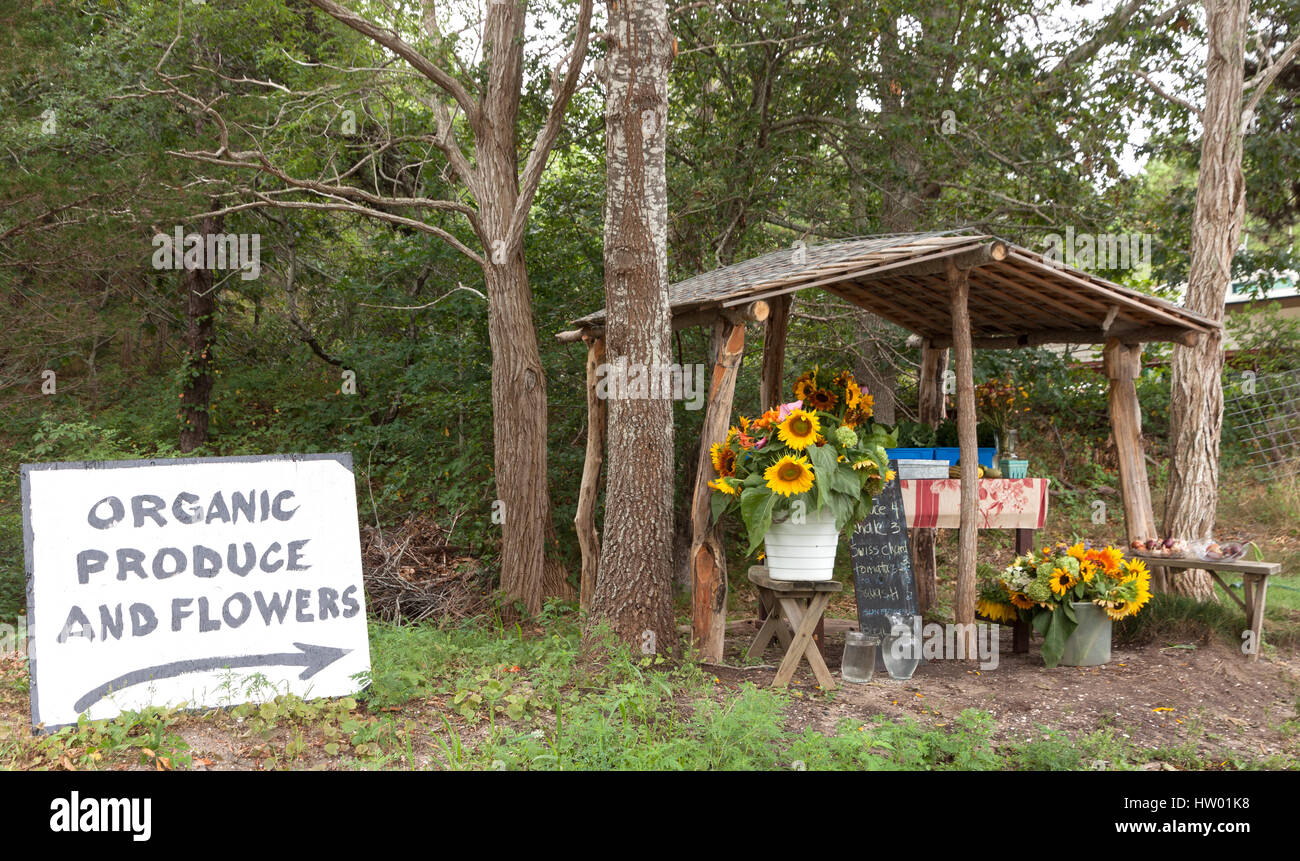 Organic produce and flower stand. - Stock Image