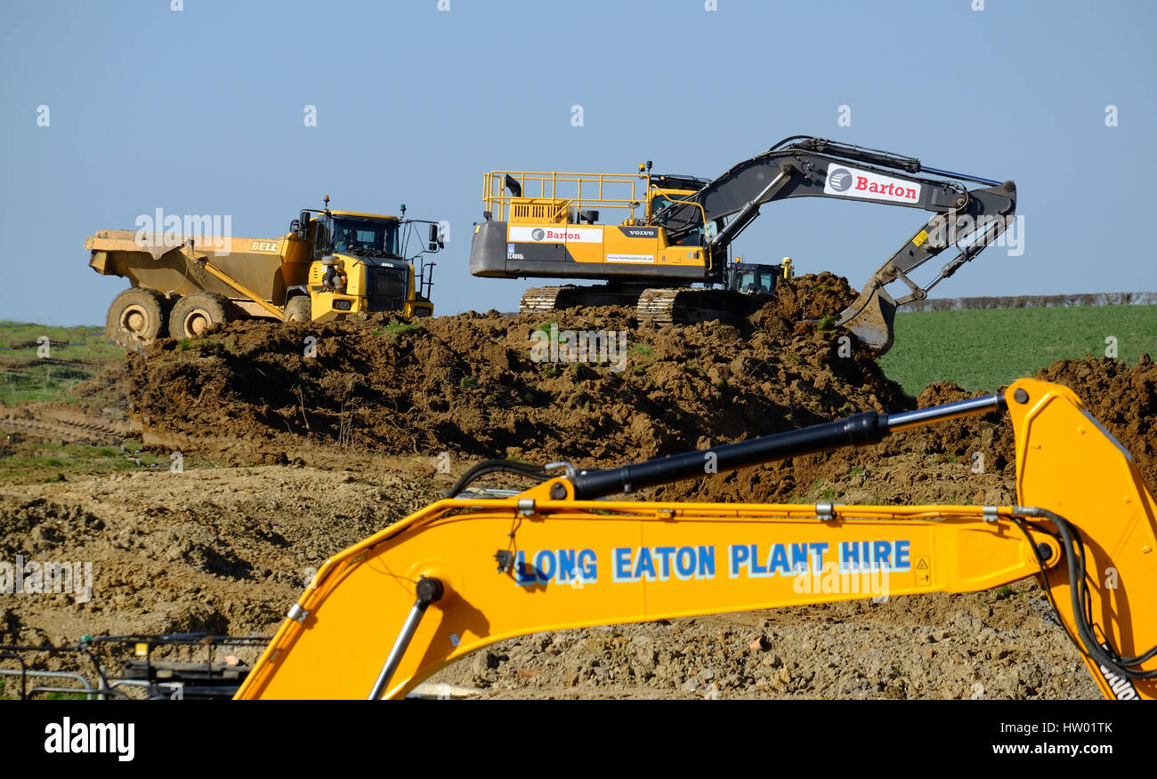 Heavy machinery used in the preparation of land for house building, Grantham Lincolnshire, England, UK. - Stock Image