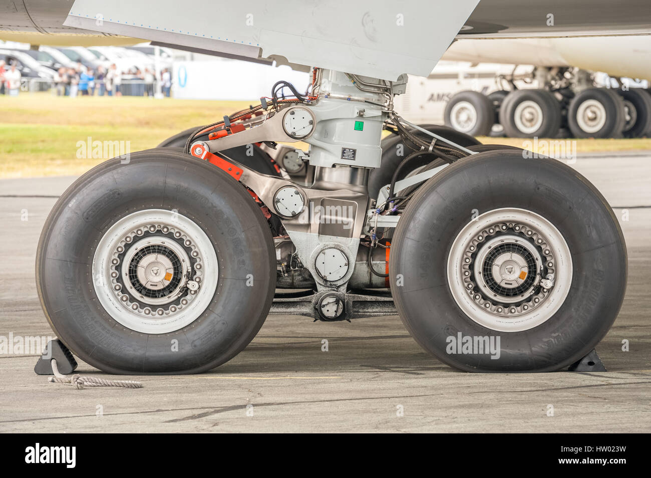Closeup section of an Airbus A350 undercarriage on the taxiway at an aviation trade event in Farnborough, UK - Stock Image
