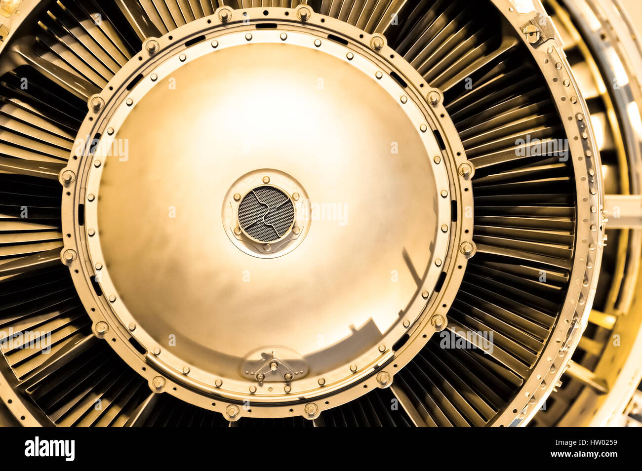 aircraft jet engine abstract with a golden tint - Stock Image