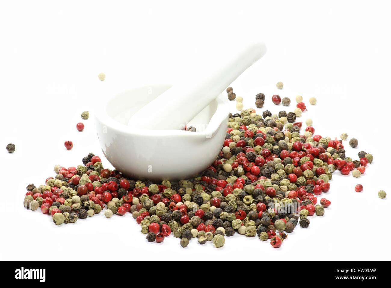 mixed peppercorns with a ceramic mortar isolated on white background - Stock Image
