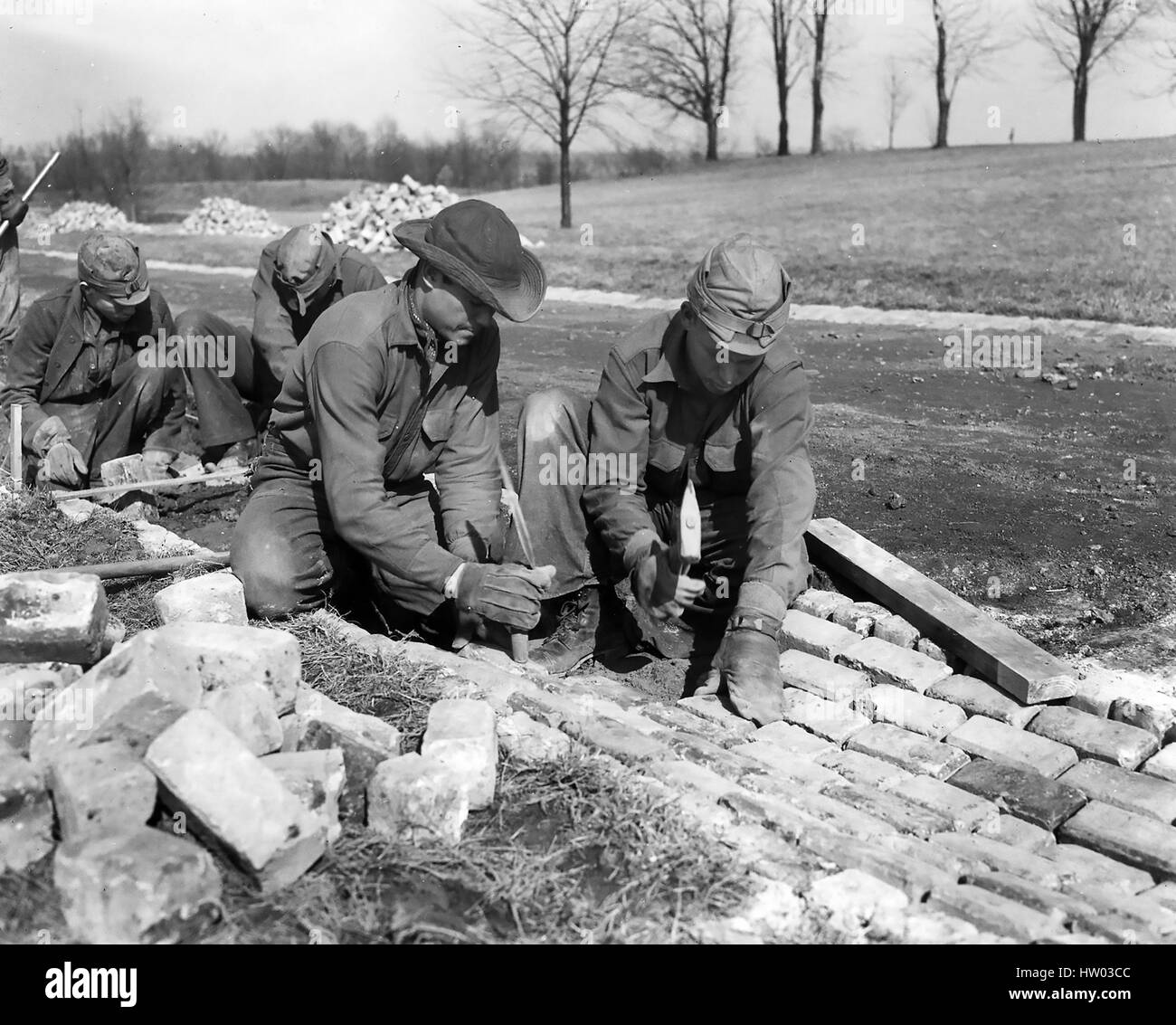 CIVILIAN CONSERVATION CORPS workers laying a road about 1933. Location unknown. - Stock Image