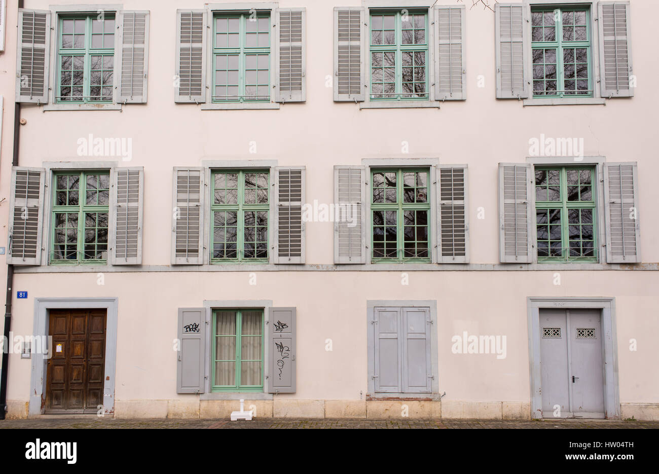 Facade of an old typical Swiss medieval house in pastel coulours in Basel old town, Altstadt Grossbasel, Switzerland. Stock Photo