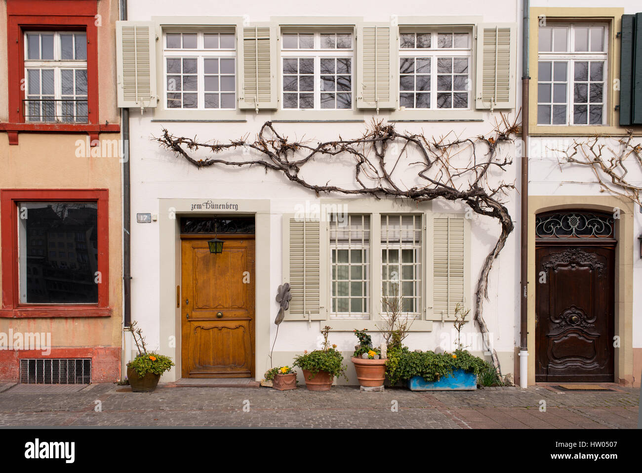 Facade of old medieval houses with wooden doors in Basel old town, Altstadt Grossbasel, Switzerland. - Stock Image