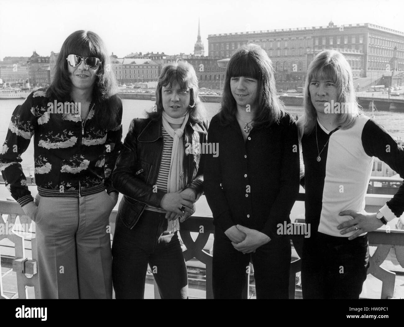 The Sweet British pop group 1975 with the Stockholm Royal Palace in background.Band member  Brian Conolly-Andy Scott - Stock Image