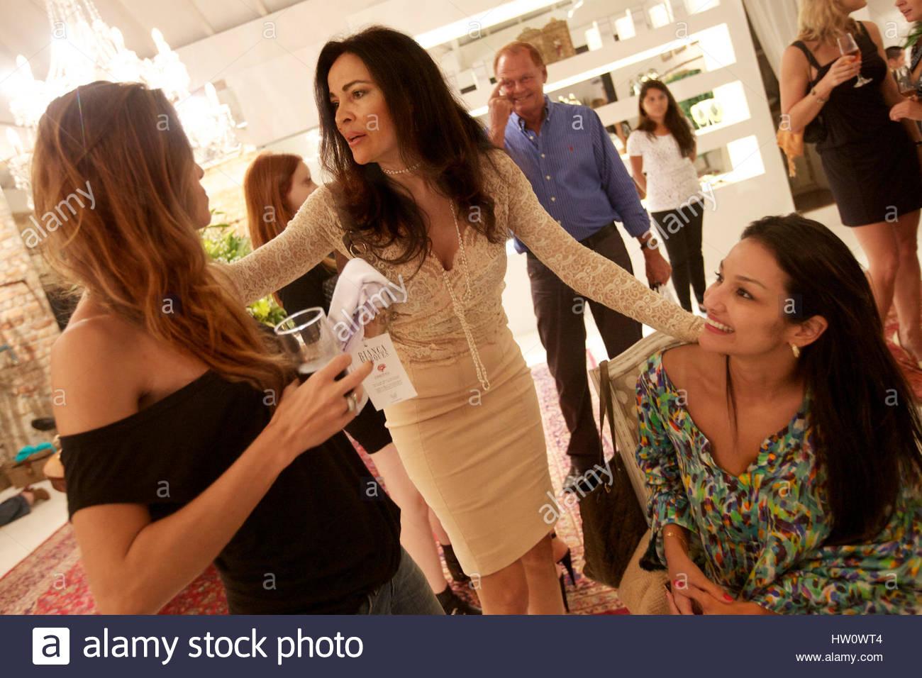 High society women gather at an expensive fashion event in Rio de Janeiro, Brazil. - Stock Image