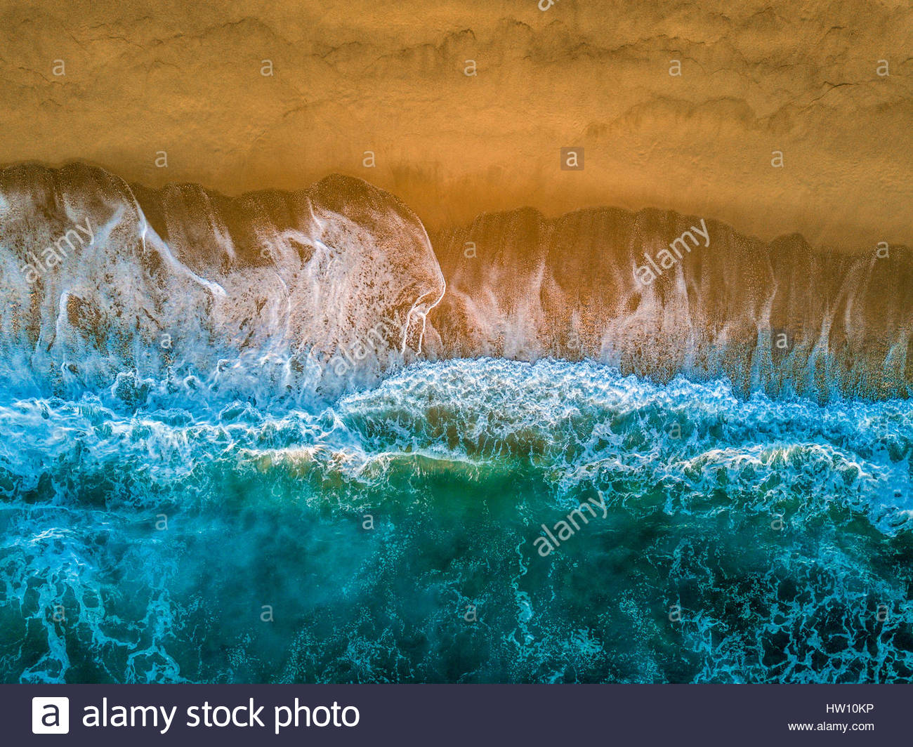 An aerial view of waves crashing against the Baja coastline. - Stock Image