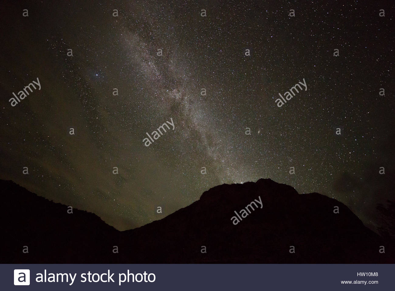 The Milky Way shines above the silhouetted Buckhorn Wash pictographs. - Stock Image
