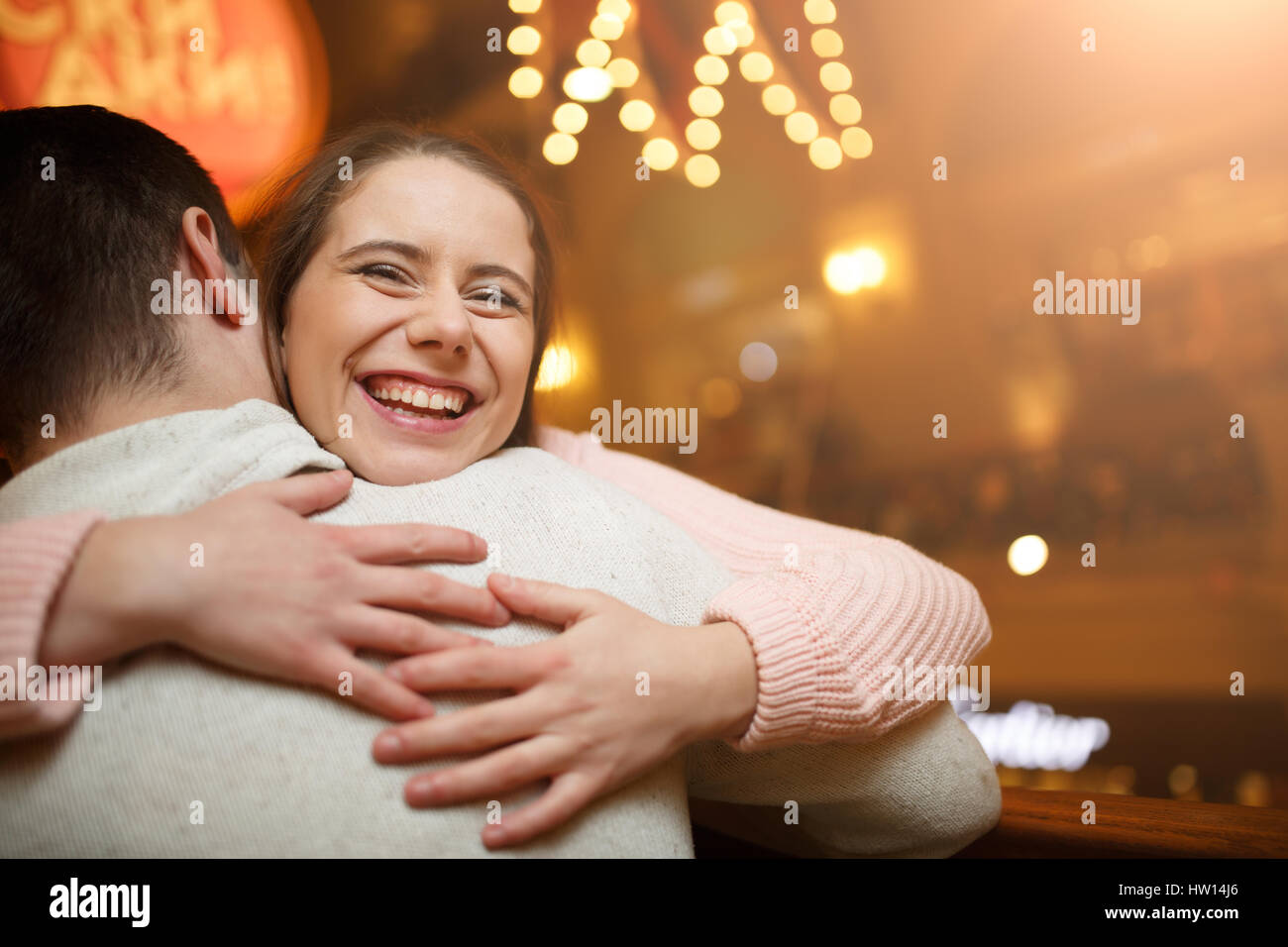 Laughing couple at shopping mall - Stock Image
