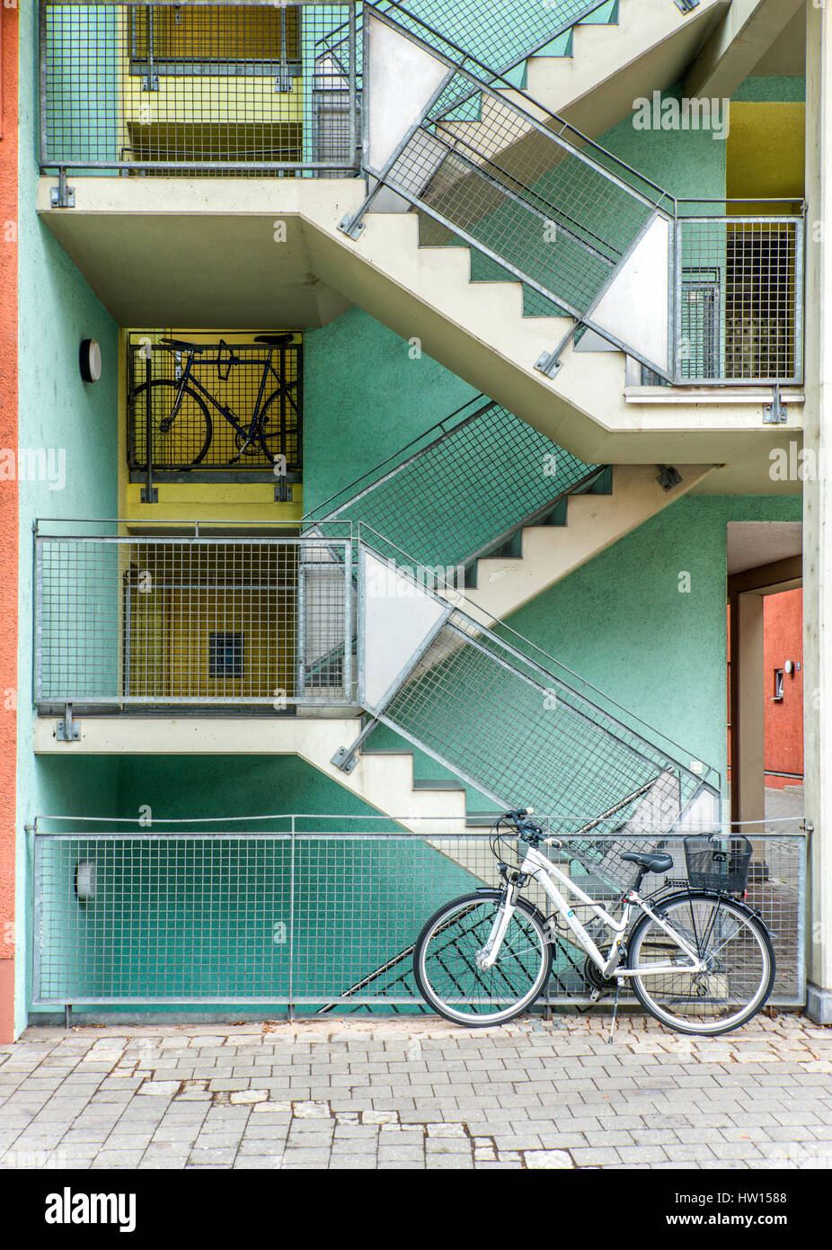 bicycle leant against modern apartment block in germany - Stock Image