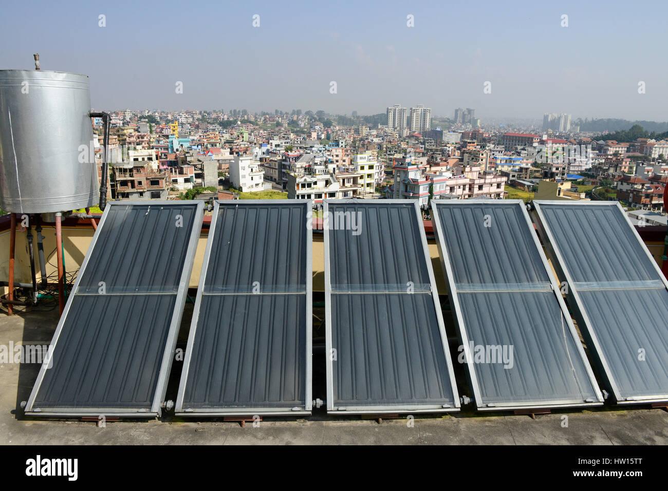 NEPAL Kathmandu, appartment building with solar collector for water heating / Haus mit Sonnenkollektor fuer Warmwasseraufbereitung - Stock Image