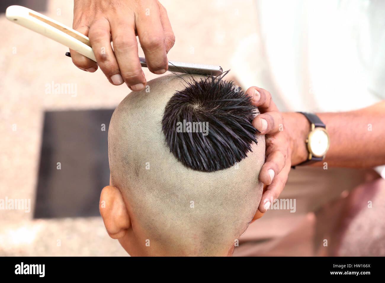 Getting a hair-cut for thread ceremony, Upanayana, a Hindu ritual