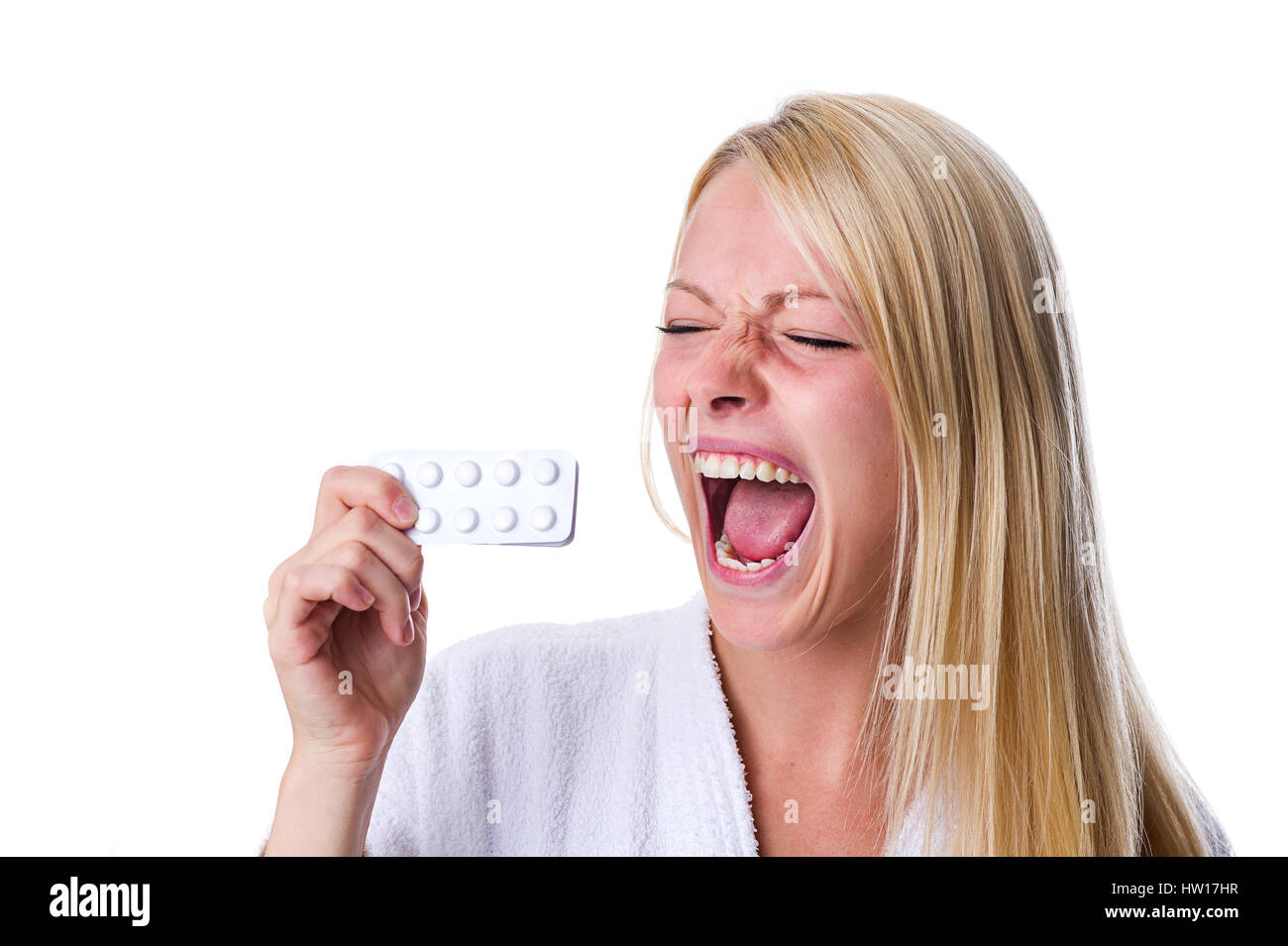 Woman with pill packet in the mouth, Frau mit Pillenpackung im Mund Stock Photo