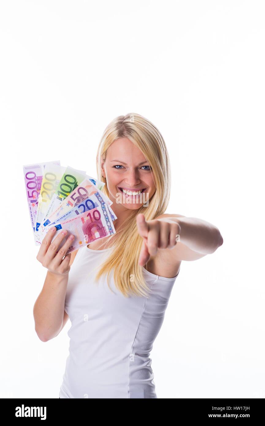 Blonde with different euro-bank notes in the hand, Blondine mit verschiedenen Euro-Banknoten in der Hand - Stock Image