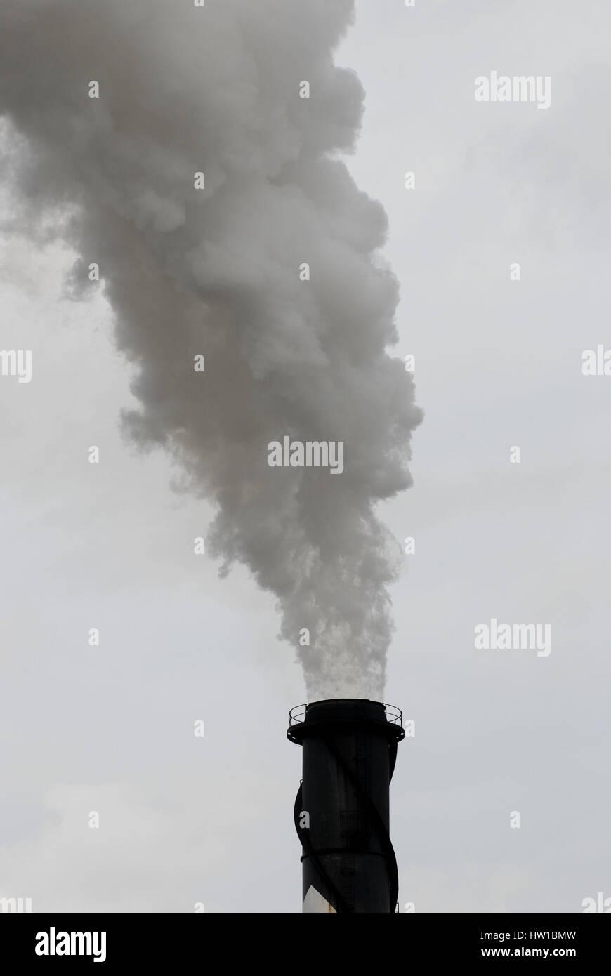 smoking industrial chimney, rauchender Industriekamin Stock Photo