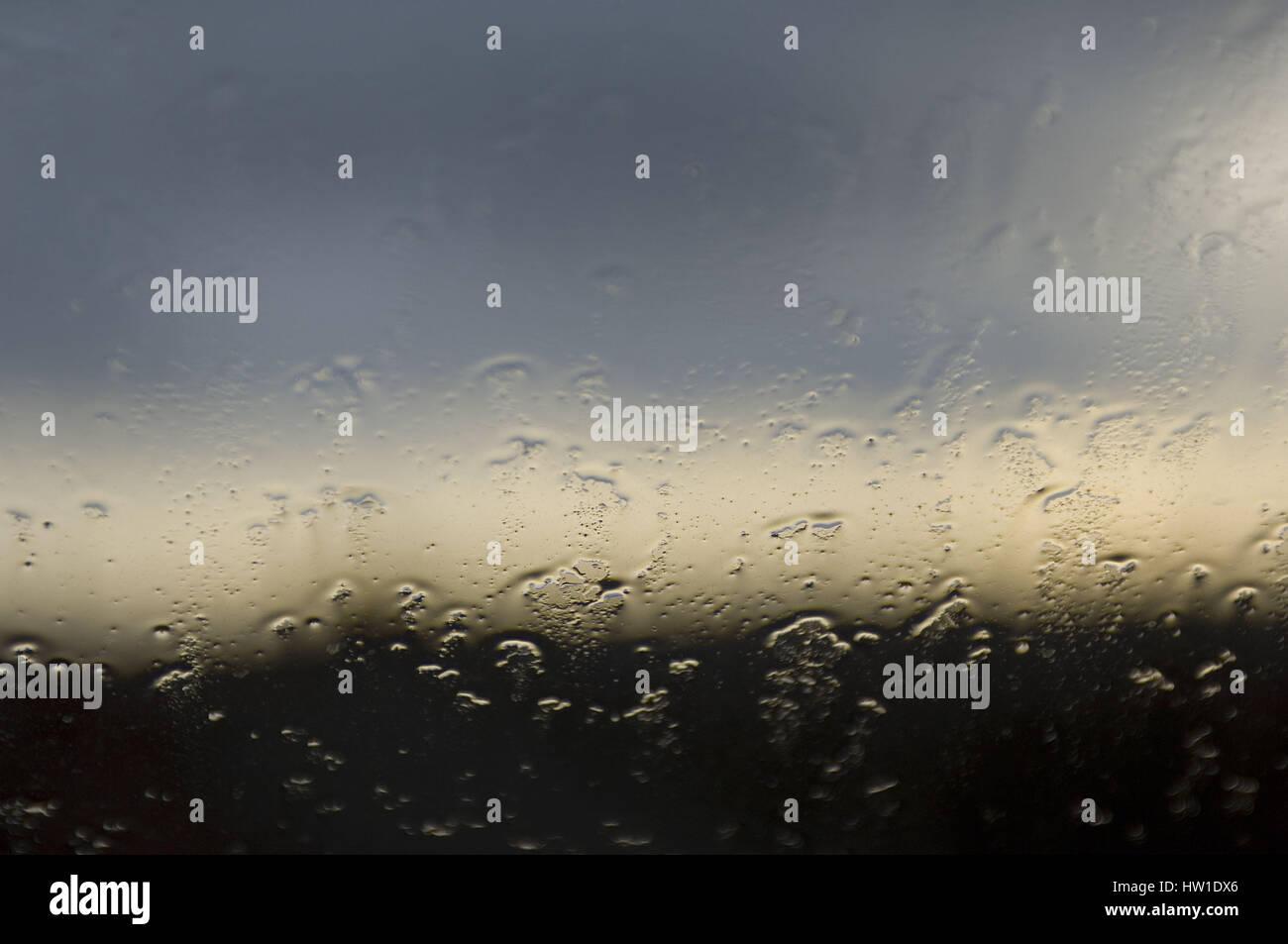 Raindrops on a window pane, Regentropfen auf einer Fensterscheibe - Stock Image