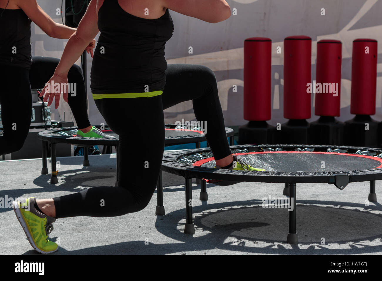 b3af5cf7fee3f Mini Trampoline Workout  Girl doing Fitness Exercise in Class at Gym ...