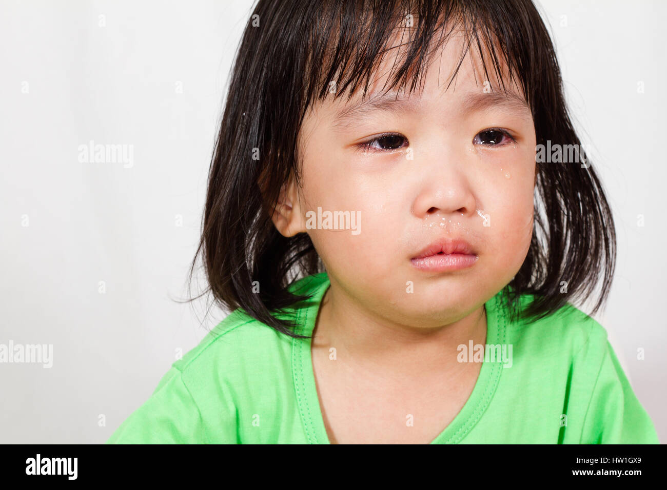 Little Asain Chinese Crying in white background - Stock Image
