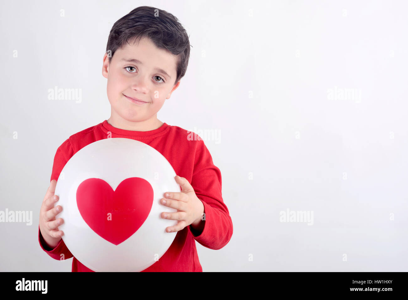 Smiling child with a heart - Stock Image