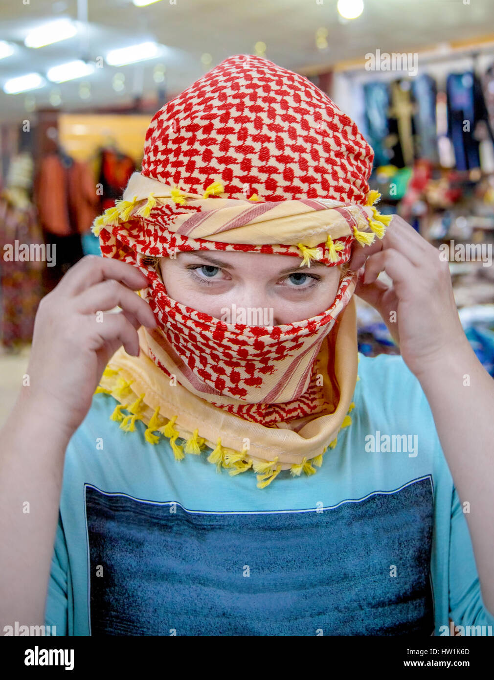 girl of Slavic appearance wearing a headscarf Arab - Stock Image