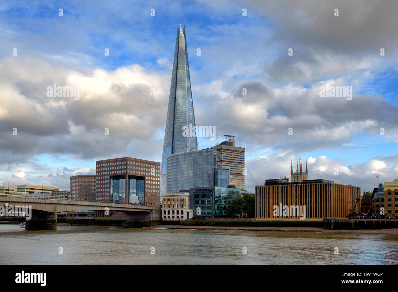 The Shard, New London Bridge and surrounding buildings with blue sky and clouds, daytime. London UK - Stock Image