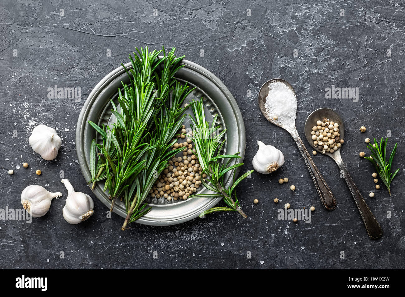 Rosemary, garlic, salt and white pepper, culinary background with various spices, directly above, flat lay, copy - Stock Image