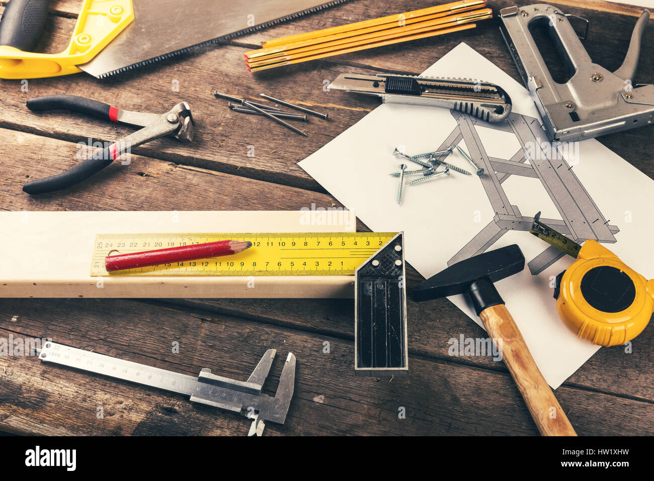 carpenter diy tools on old wooden table in workshop Stock Photo