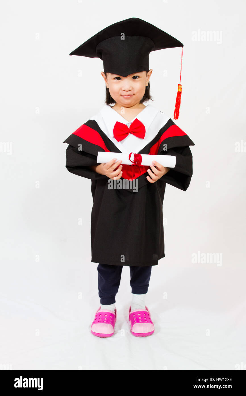 Chinese little girl graduation in white backround studio shot. - Stock Image