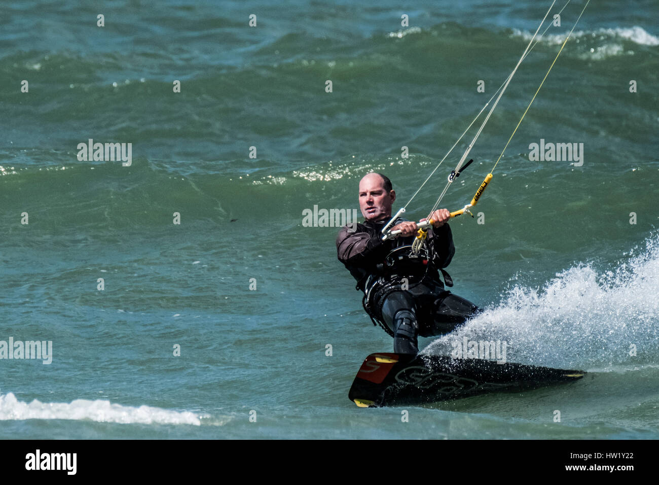 A kitesurfer in Klitmoller which is a popular windsurfing destination in Northern Denmark. Klitmoller is also known - Stock Image